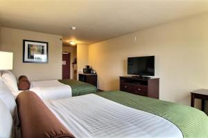 A television and/or entertainment center at Cobblestone Hotel and Suites - Crookston