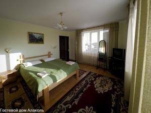 Кровать или кровати в номере Guesthouse Alakol