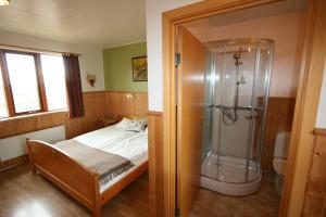 A bed or beds in a room at Árnanes Country Hotel