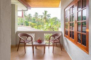 Ein Balkon oder eine Terrasse in der Unterkunft Johnson House Sri Lanka