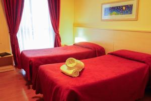 A bed or beds in a room at Hotel Break House Ristorante