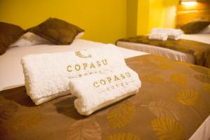A bed or beds in a room at Copasu Hotel
