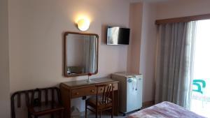 تلفاز و/أو أجهزة ترفيهية في فندق نيو بولا