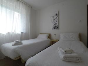 A bed or beds in a room at Casa Martello
