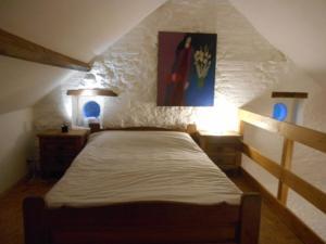 A bed or beds in a room at Ferme du Pont de Bois - Le Fenil