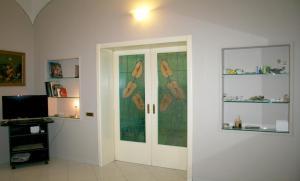 Télévision ou salle de divertissement dans l'établissement Montebello Apartment - Termini Station