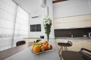 Кухня или мини-кухня в Arcadia Palace