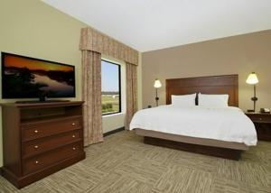 A bed or beds in a room at Hampton Inn & Suites Madisonville
