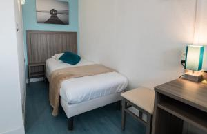 Un ou plusieurs lits dans un hébergement de l'établissement Hôtel Eden
