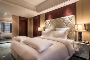 A bed or beds in a room at Pullman Beijing South