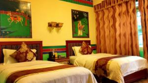 A bed or beds in a room at Tashi Choeta Boutique Hotel