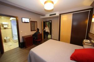 Кровать или кровати в номере Complejos J-Enrimary