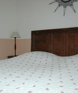 Un ou plusieurs lits dans un hébergement de l'établissement Mas Bella Cortis