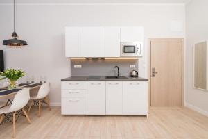מטבח או מטבחון ב-Aparthotel Avenue 22
