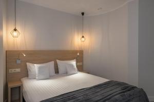 מיטה או מיטות בחדר ב-Aparthotel Avenue 22