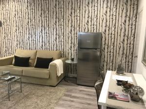 Una televisión o centro de entretenimiento en Apartamento Gran Via Callao