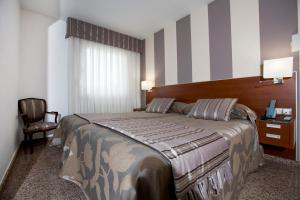 A bed or beds in a room at Hotel Marivella