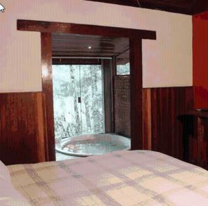 Cama ou camas em um quarto em Pousada no Caminho do Marimbondo