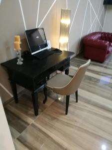 A television and/or entertainment center at Hotel Bruman