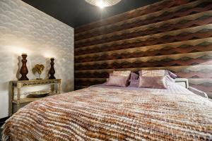 A bed or beds in a room at Casa Lavanda