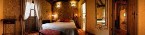 Cama o camas de una habitación en El Mirador de Almanzor