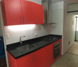 A kitchen or kitchenette at Mi casa es su casa
