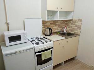A kitchen or kitchenette at Apartment in center of Balashikha