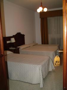 Cama o camas de una habitación en Hotel Río Piscina