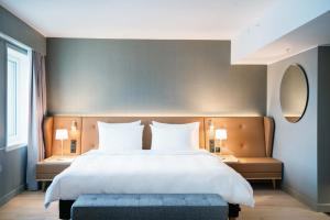 A bed or beds in a room at Radisson Blu Atlantic Hotel, Stavanger