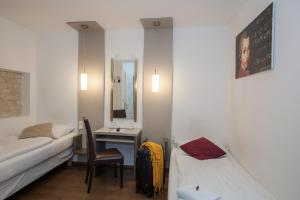 A bed or beds in a room at Urban Stay Villa Cicubo
