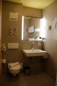 Ein Badezimmer in der Unterkunft Pension Vicus