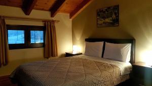Ένα ή περισσότερα κρεβάτια σε δωμάτιο στο Ξενώνας Οδυσσέας