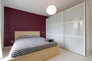 A bed or beds in a room at Rooftop Luxembourg Ville