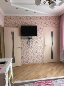 Телевизор и/или развлекательный центр в Bungalow na Bannom