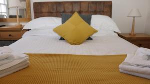 The Horseshoe Inn tesisinde bir odada yatak veya yataklar