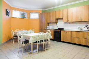 A kitchen or kitchenette at Bukhta №5 Guest House