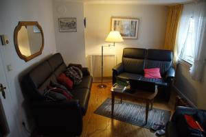 Een zitgedeelte bij Ferienhaus Schuck