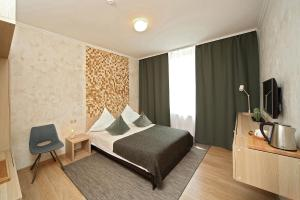 A bed or beds in a room at De`Lore Park Hotel Domodedovo