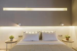 Ένα ή περισσότερα κρεβάτια σε δωμάτιο στο Golden Beach