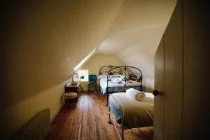 A bed or beds in a room at The Dell of Abernethy