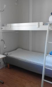A bunk bed or bunk beds in a room at Hjortsbergagården