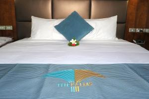 Ein Bett oder Betten in einem Zimmer der Unterkunft The Palms Denarau Fiji