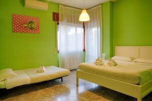 Een bed of bedden in een kamer bij Pascià Room & Breakfast
