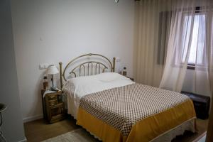 A bed or beds in a room at Quinta Manel da Gaita