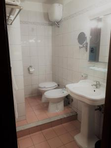 A bathroom at Hotel Sweet Home