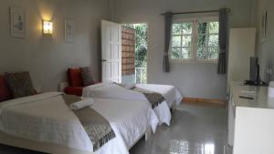 A bed or beds in a room at Bamboo House Resort