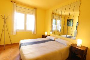 Llit o llits en una habitació de Apartament Antic Plankton