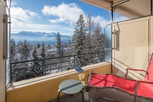 A balcony or terrace at Crans-Montana Youth Hostel