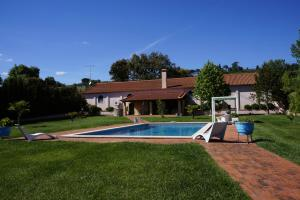 The swimming pool at or near Quinta dos Moinhos