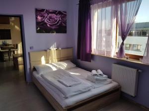 Łóżko lub łóżka w pokoju w obiekcie Apart Swinoujscie